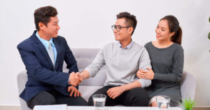 couple speaking to an agent if they are qualified to buy an HBD flat