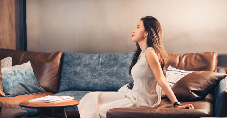 a woman landowner thinking about interior design questions